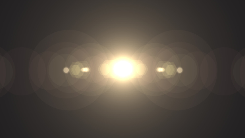 Symmetrical optical lens flares transition that is a seamless loop with natural lighting. 4K  Royalty-Free Stock Footage #1046319937
