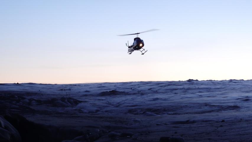 Helicopter landing on glacier Iceland morning light.mov