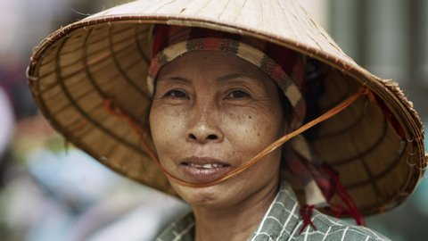 Handheld video shows of Vietnamese senior woman. Shot with RED helium camera in 8K