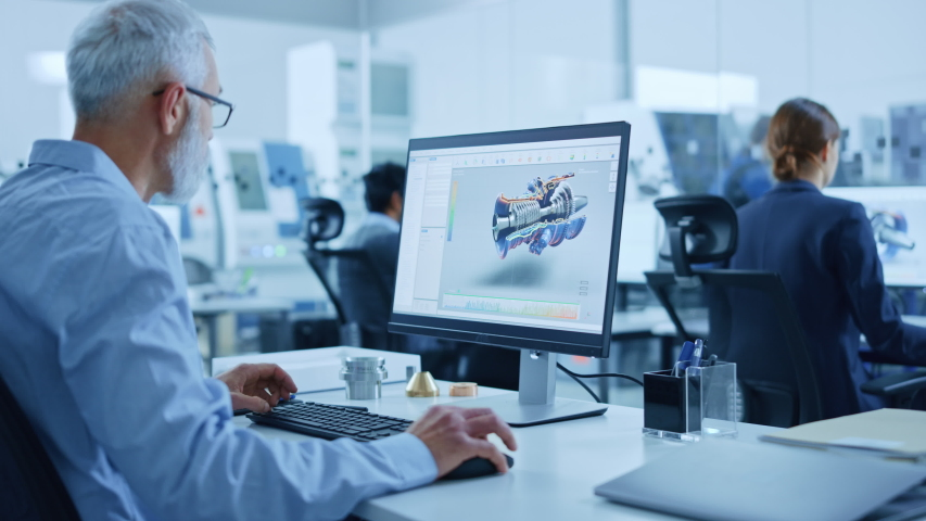 Modern Industrial Factory: Team of Mechanical Engineers Working on Computers, Using Newest High-Tech Devices Like Virtual Reality Headsets to Design Best Engines. 3D Graphics in Contemporary Industry | Shutterstock HD Video #1046400595