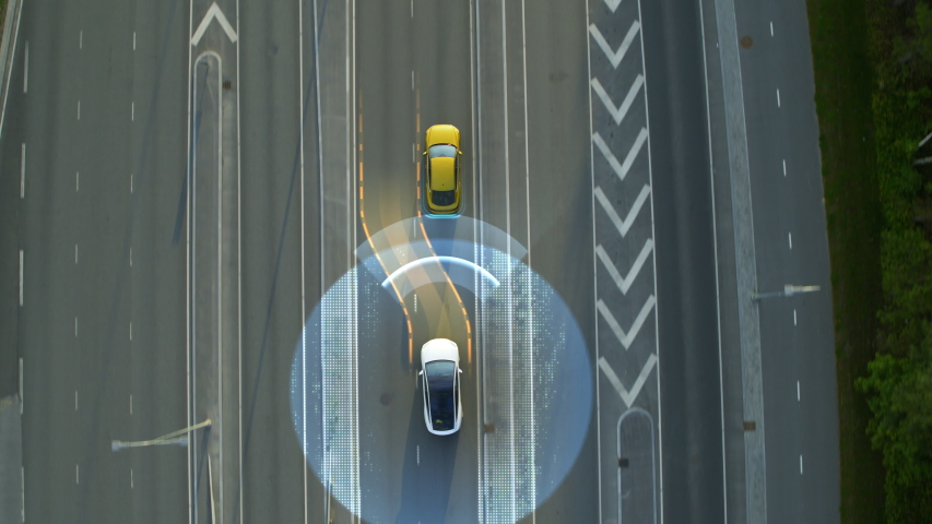 Aerial Top Down View: Autonomous Self Driving Car Moving Through City, Overtaking Other Vehicles. Animated Scanning Visualization Concept: Artificial Intelligence Digitalizes and Analyzes Road Ahead