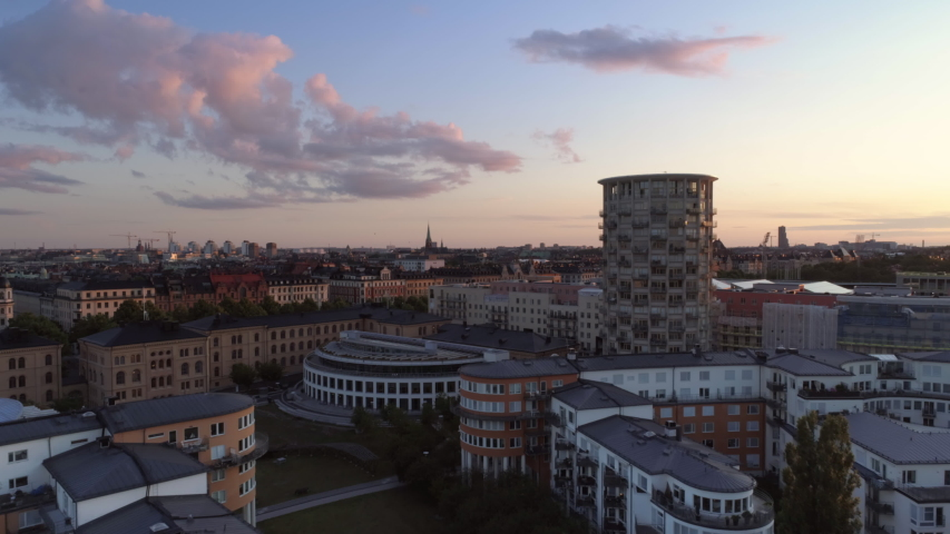 Aerial view of high-rise buildings in Stockholm, Gärdet at sunset. Drone shot flying by, Östermalm cityscape skyline in the background. Capital city of Sweden Royalty-Free Stock Footage #1046414560