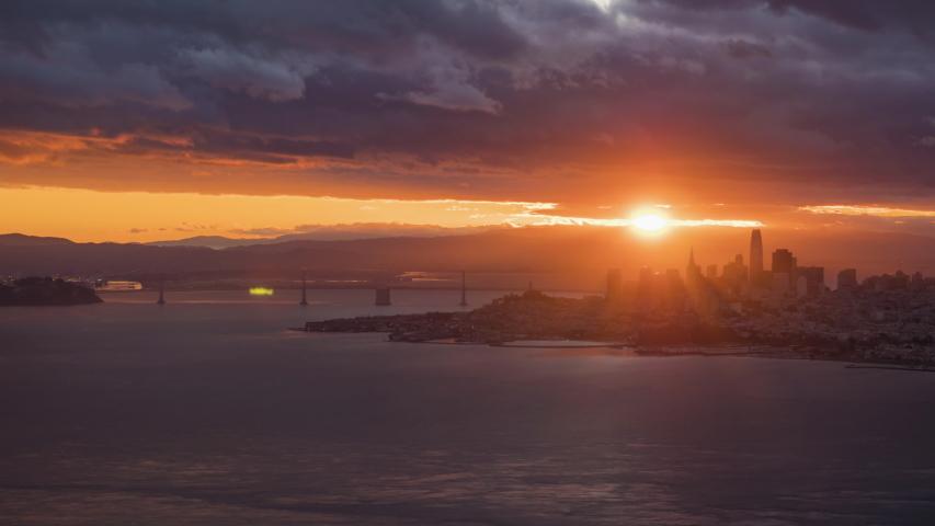 San Francisco Downtown and Oakland Bay Bridge at Sunrise. Time Lapse. California, USA