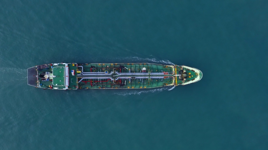 Aerial view cargo ship of business logistic sea freight, Crude oil tanker lpg ngv at industrial estate Thailand  Group Oil tanker ship to Port of Singapore - import export. 4K | Shutterstock HD Video #1046468425