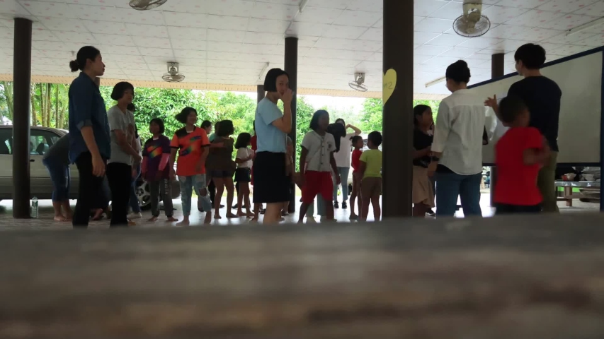 PhangNga, Thailand - 10 Feb. 20: Youth Volunteers from diversity nations make friend with Asian students or children group by singing & playing games together, Kids club & School activity TimeLapse