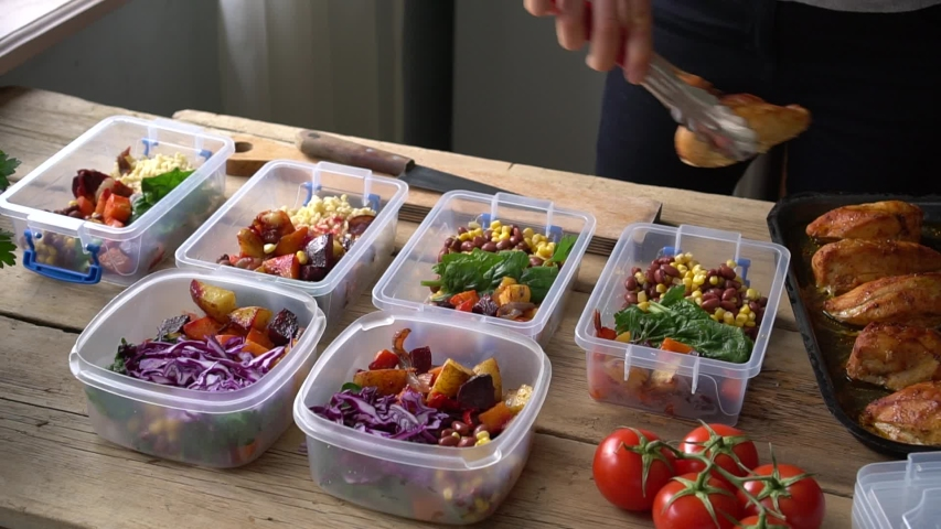 Meal Prep Containers. Planning and preparing healthy meals. Organic produce and ingredients. Oven-Ready and Pre-Prepped meals Royalty-Free Stock Footage #1046511352