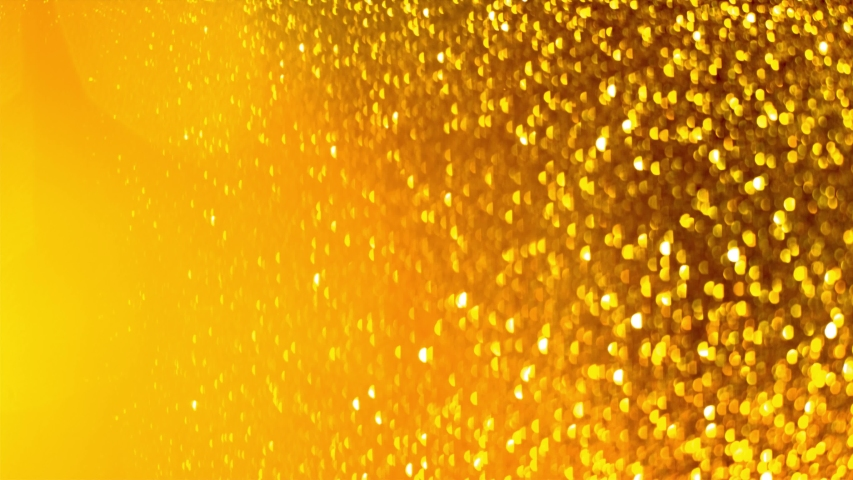 Falling gold glitter particles. Falling shiny confetti with magic, sparkling, bokeh light | Shutterstock HD Video #1046580322
