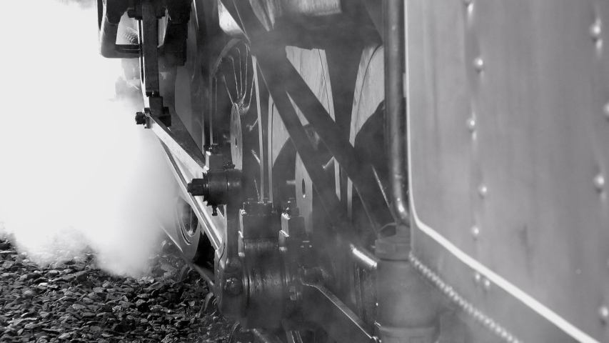 Close up of steam train wheels with smoke UK 4K | Shutterstock HD Video #1046585896