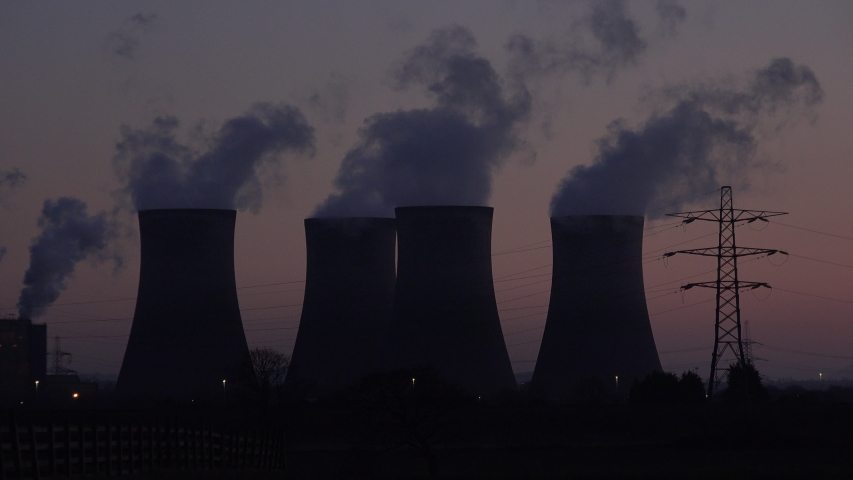 Coal fired power station near Manchester and Liverpool in the north of England. Evening sunset as smoke goes into the skies UK 4K | Shutterstock HD Video #1046586136