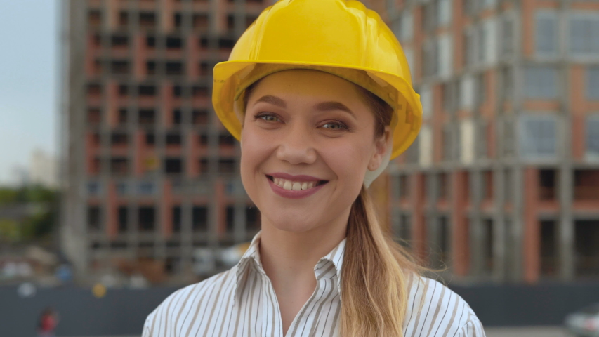 Portrait successful senior construction engineer woman smiling enjoying professional career success wearing hard hat safety helmet female ambition 4K | Shutterstock HD Video #1046612212
