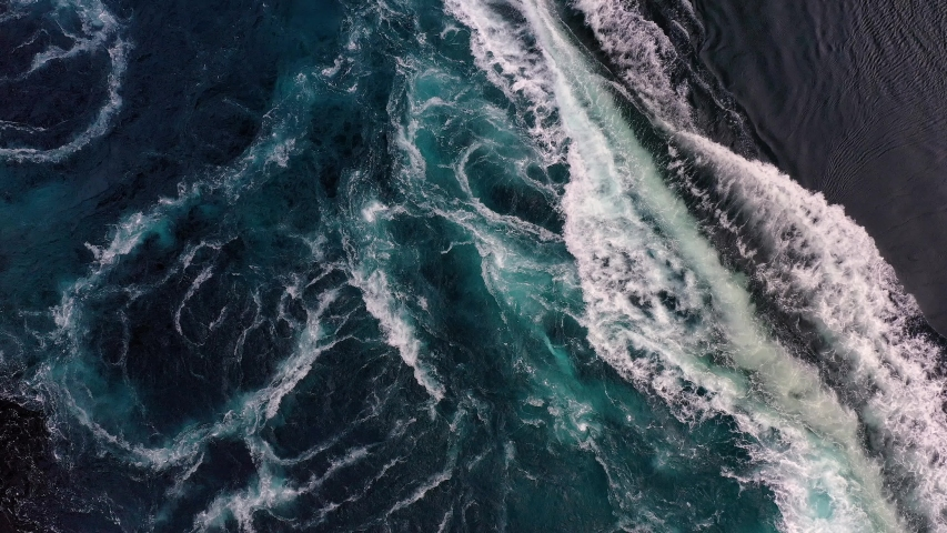 Waves of water of the river and the sea meet each other during high tide and low tide. Whirlpools of the maelstrom of Saltstraumen, Nordland, Norway Royalty-Free Stock Footage #1046650435