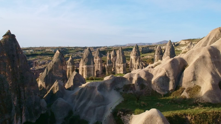 Aerial view of fungous forms of sandstone in Cappadocia ,Drone footage over volcanic hills at Cappadocia Turkey | Shutterstock HD Video #1046657077