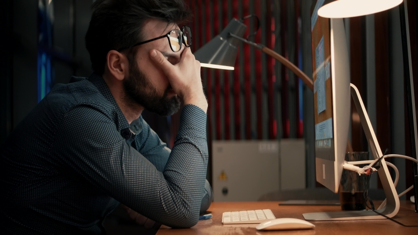 Tired Worker Overworked On Computer.Frustrated Businessman Working Alone.Office Work Overtime. Workaholic Work In Internet Deadline.Tired Businessman In Night Office.Overwhelmed Exhausted Stressed Man Royalty-Free Stock Footage #1046661682