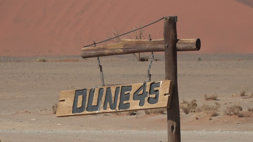 Dune 45 wooden sign in the Sossusvlei area of the Namib Desert in Namibia | Shutterstock HD Video #1046677906
