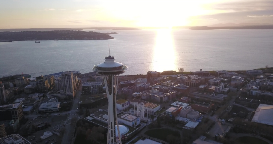 Seattle, Washington, United States - February 3, 2020: Aerial drone flight over Seattle Washington at sundown.  The Space Needle is centred in the frame against the setting sun.