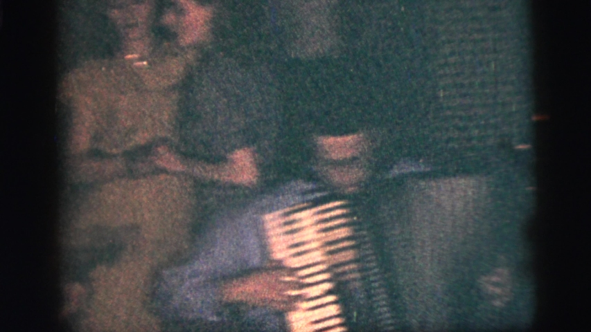 NEW YORK CITY-1956: Two Women Dance Together At A Party While A Man Plays The Accordian