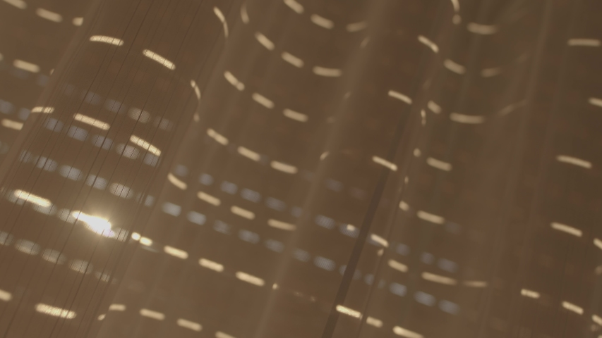 Raising the blinds in the morning light, shooted by Blackmagic Pocket Cinema Camera 6K BRAW stock footage.  | Shutterstock HD Video #1046723500