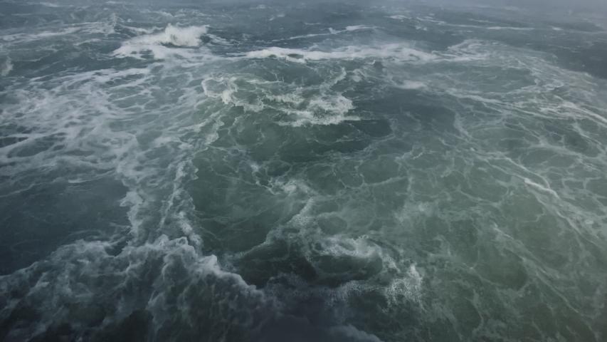 Rough stormy ocean waves in the rain. Waves near Niagara Falls   Shutterstock HD Video #1046743450