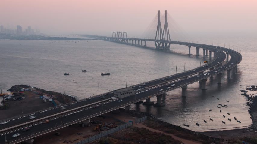 4K Day to Night Zooming Out Sunset Timelapse of the car traffic on the famous Bandra Worli Sea Link Bridge, Mumbai, Maharashtra, India.