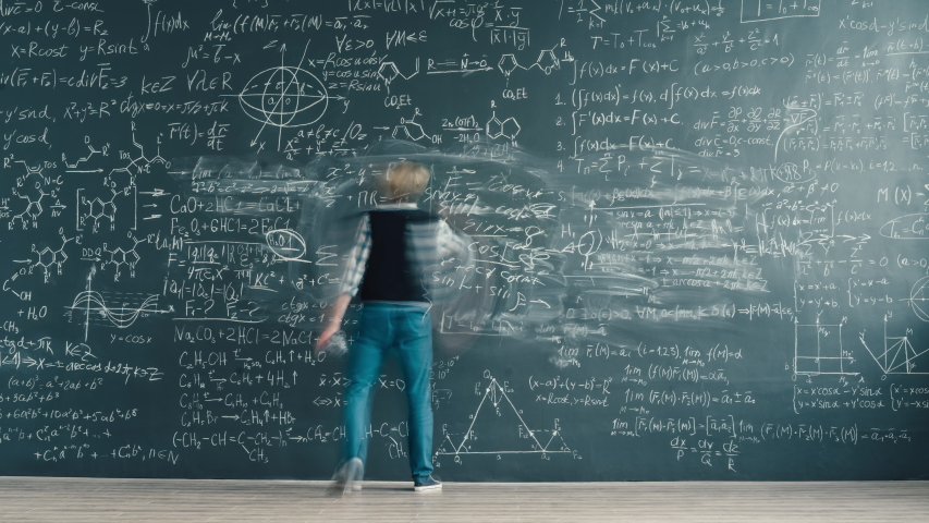 Zoom-in time-lapse of smart person solving scientific problem writing formulas on chalkboard focused on studies. People and knowledge concept.