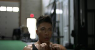 Intense workout by gay asian man in a gym. Fitness program. Ideal for sports videos.