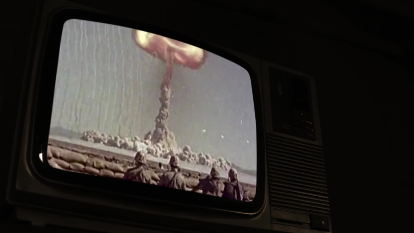 Atomic Explosion on a Vintage TV. Sepia Tone. Public Domain Footage from the US Army.