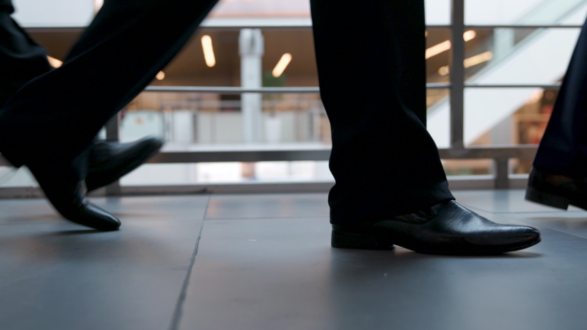 Office Managers and Businesspeople Going to Work Closeup. Businessperson Legs in Shoes Walking to Office Center. Urban Business Lifestyle Background. Pedestrians Unrecognizable Person Walking in City.