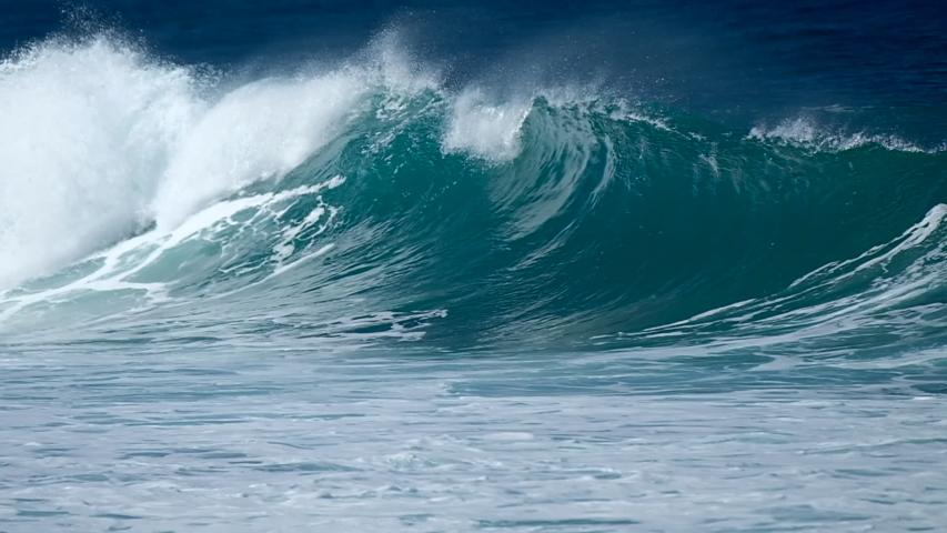 Wave breaks at the Banzai Pipeline surf spot on Oahu island in Hawaii | Shutterstock HD Video #1046878522