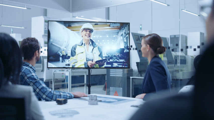 Diverse Group of Specialists, Managers in the Factory Office Meeting Room, Have Conference Video Call with Factory Chief Female Engineer, She Talks about Production Growth, Uses Tablet Computer Royalty-Free Stock Footage #1046904694