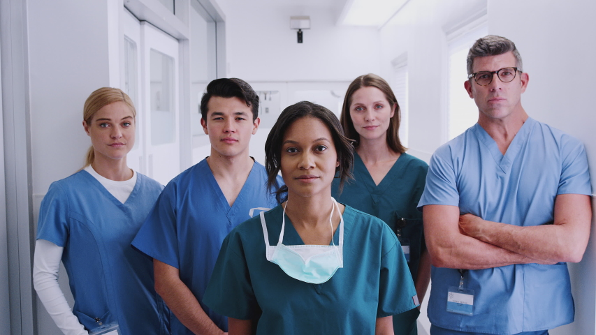 Portrait of multi-cultural medical team standing in hospital corridor - shot in slow motion Royalty-Free Stock Footage #1046910598