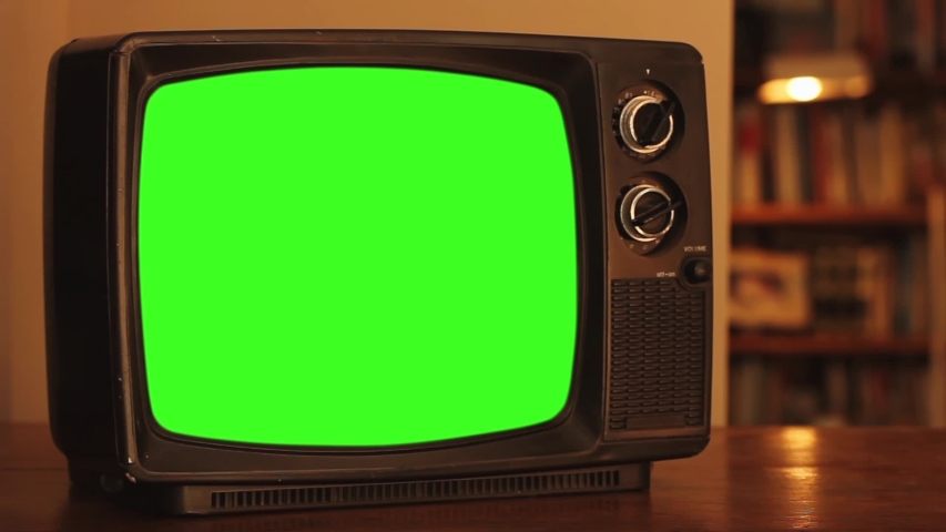 """Old TV Set with Green Screen. Zoom In. Red Tone. You can Replace Green Screen with the Footage or Picture you Want with """"Keying"""" effect in After Effects (check out tutorials on YouTube). 
