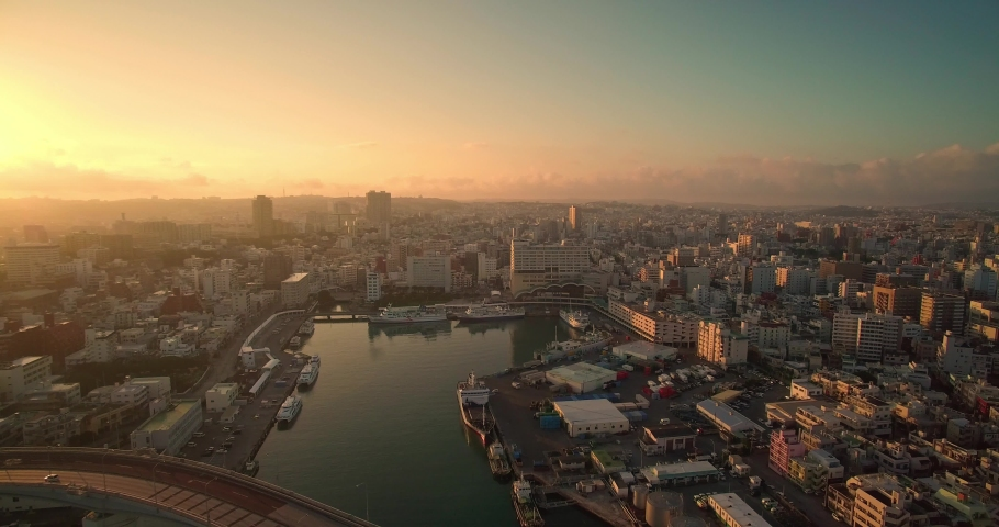 Aerial view of Naha city Okinawa Japan at sunrise with ocean views and Tomari port drone shot | Shutterstock HD Video #1046942695