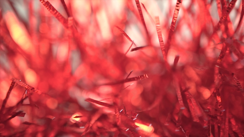 Close up cheering poms likes a majority red glitter flowers, view of red sparkle twinkle stuffs became phantasm, dreamlike and fantasy. | Shutterstock HD Video #1046949565