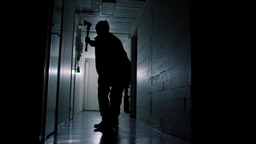 Terrifying Murderer Walking Through Strobing Lights in Creepy Hallway | Shutterstock HD Video #1046959399