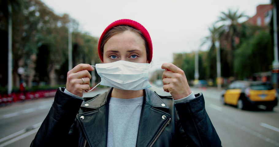 Portrait of a young student woman wearing protective mask on street.Concept of health and safety life, N1H1 coronavirus, virus protection, pandemic in china Royalty-Free Stock Footage #1046978314