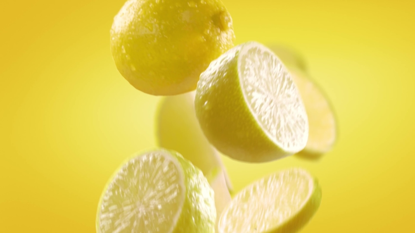Flying of Lemon and Slices in Yellow Background Royalty-Free Stock Footage #1046992573