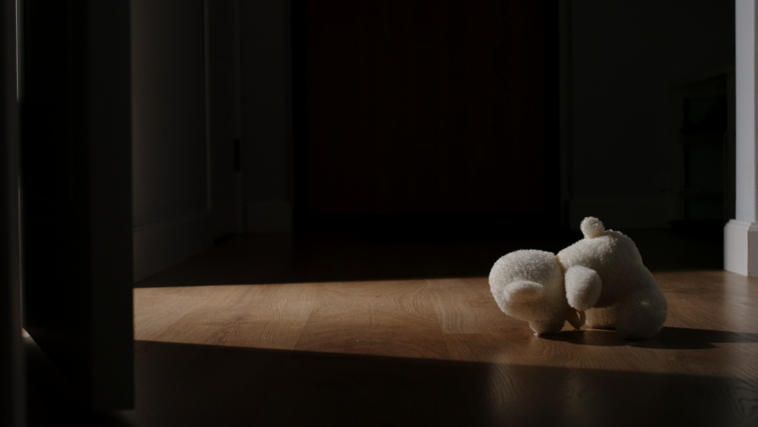 White Plush Bear Toy Is Thrown On The Floor In A Dark Room | Shutterstock HD Video #1047000970