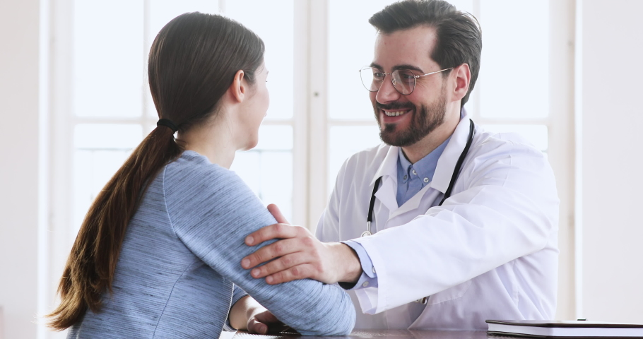 Caring kind male doctor fertility specialist supports infertile young female client  encourage woman patient give comfort at medical clinic consultation, healthcare trust empathy concept | Shutterstock HD Video #1047021436