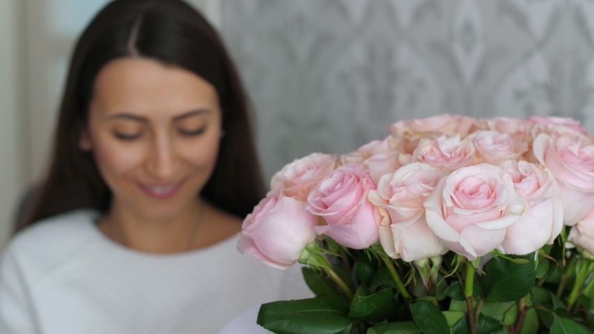 Woman receive flowers with message #1047032188