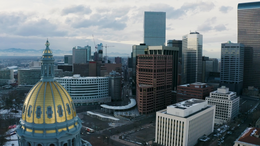 4k Aerial drone footage - Colorado State Capitol Building & the Skyline of the City of Denver Colorado at Sunset.
