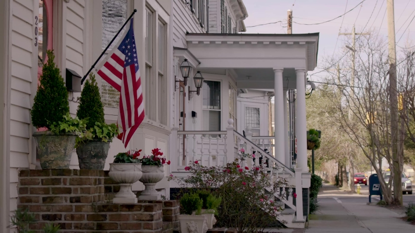 American flag in slow motion near picturesque victorian homes in Charleston   Shutterstock HD Video #1047050275