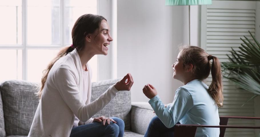 Female speech language therapist teaching preschool kid sound pronunciation, stuttering cute child having stutter;  voice ability problem speaking lesson concept #1047051049