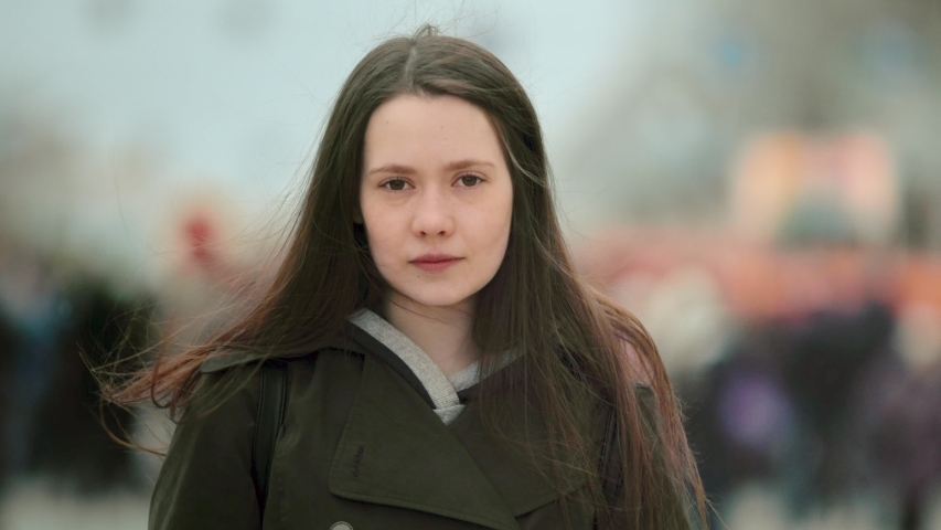 Close up one woman feminist face looking at camera stand street city. People feminism face portrait closeup. Confident serious. Adult young sad girl rebel. Independent lady fight strike revolution. Royalty-Free Stock Footage #1047058105