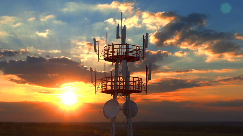 Aerial view of the top of telecommunication tower. Its antennas designed for transmitting cellular mobile signals covering large areas providing high speed 4g and modern 5g traffic network service. Royalty-Free Stock Footage #1047094033