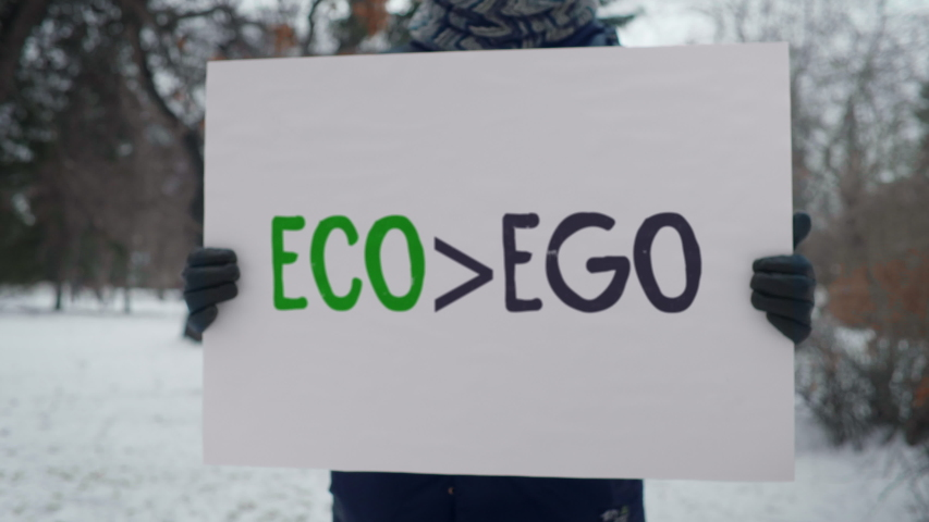 ECO>EGO. Ecology Protector, Environmentalist in the Park. One Man Protest, Day, Winter | Shutterstock HD Video #1047113833