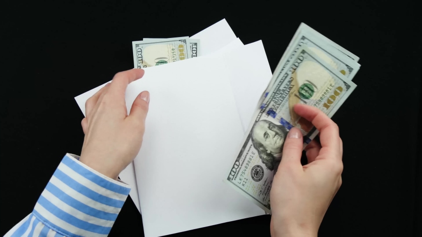 """The hand counted the money in a paper envelope, sticking a label with the inscription """"medicine"""" on the envelope with money. People allocate their personal budget, money to pay for medical services Royalty-Free Stock Footage #1047116632"""