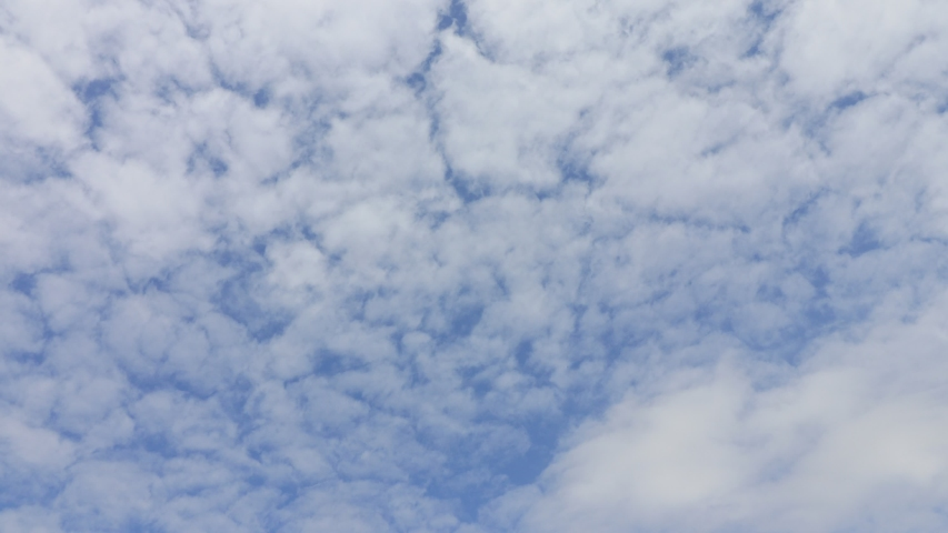 Blue sky and white clouds 4K time-lapse Royalty-Free Stock Footage #1047119074