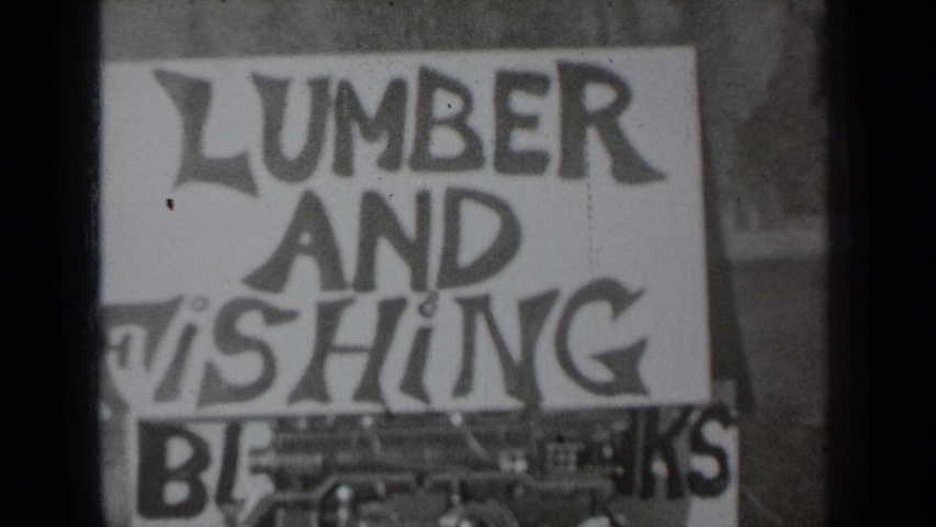 KLAMATH CALIFORNIA-1937: A Sign That Reads Lumber And Fishing Is Covering An Old Sign   Shutterstock HD Video #1047146275