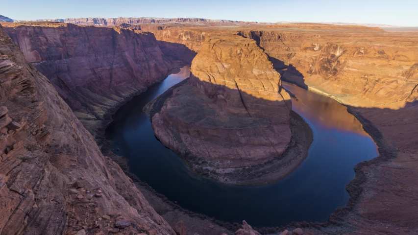 Horseshoe Bend on Sunny Morning. Colorado River Meander. Arizona, USA. Moving Panning Time Lapse. Wide Shot | Shutterstock HD Video #1047172975