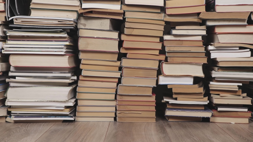 Pile of book with in the attic, camera pushing in   Shutterstock HD Video #1047177220